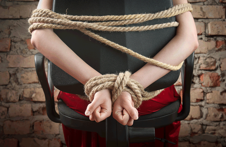 Person tied up with ropes
