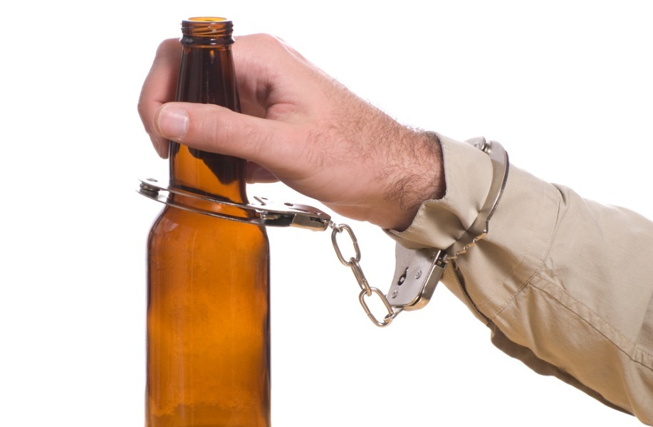 handcuffed to a bottle