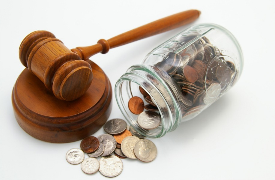Judge's gavel with money jar