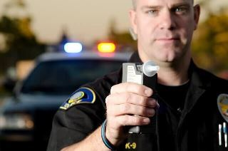 York DUI lawyer - police officer with breathalyzer