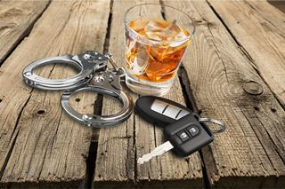 Augusta DUI lawyer - handcuffs and alcohol