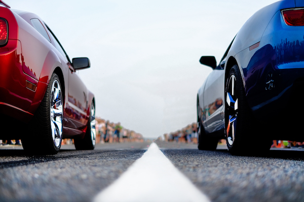 Two cars about to enter a speed contest in violation of CRS 42-4-1105.