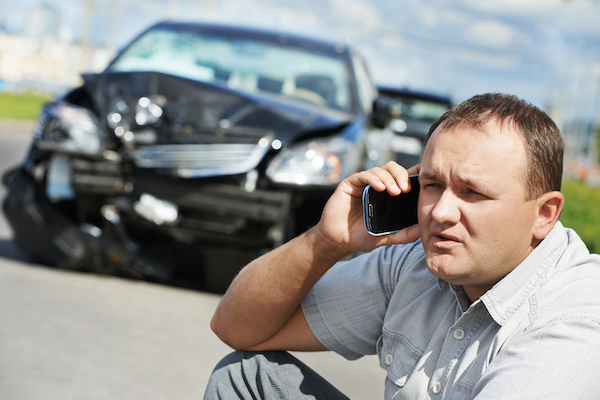Driver calling for help following an accident in accordance with Colorado law.