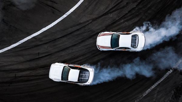 Two cars legally racing on a Colorado speedway.