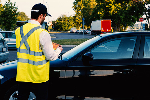 parking enforcement issuing parking ticket
