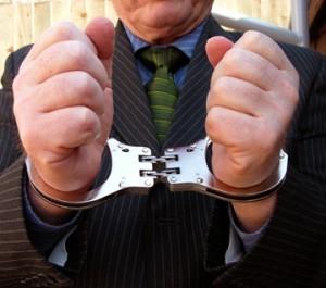 Suited_man_cuffs