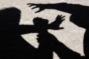 shadow-of-person-assaulting-another