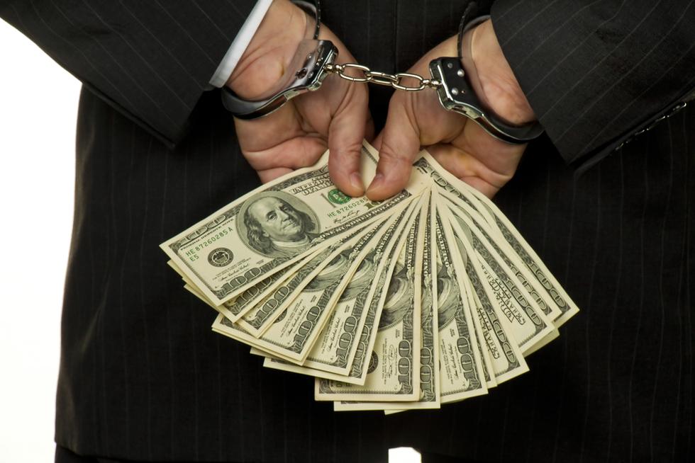 Embezzlement cuffedhands money