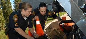 Officers looking into a trunk