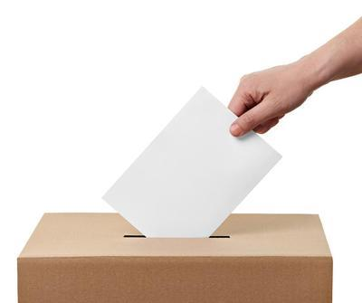 a letter being put in a ballot box