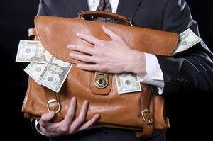 Man-clutching-bag-full-of-money