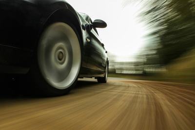 Speeding-car-wheels-23109