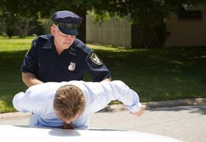 cop arresting a man