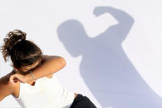 Woman-cowering-shadow-of-man-with-fist-raised