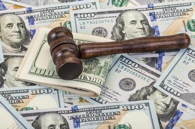 gavel-on-top-of-money-representing-criminal-fines