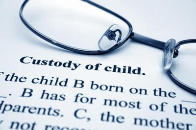 "pair of glasses on top of paper that reads ""custody of child"""