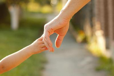 parent and child touching hands