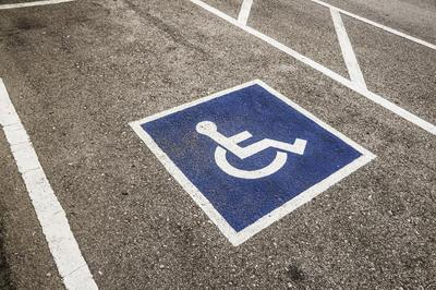disabled parking sign on parking space asphalt