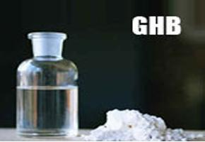 bottle of mixed GHB next to GHB powder