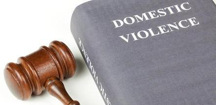 Gavel-beside-book-on-domestic-violence