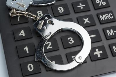 handcuffs-and-computer-keyboard