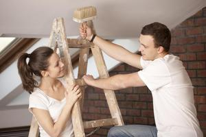 couple on a ladder building