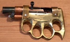Img-brass-knuckle-gun-optimized