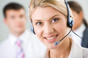 blonde female receptionist wearing headset