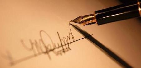 Fountain pen signing a document