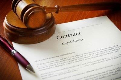 a gavel on top of a printed contract