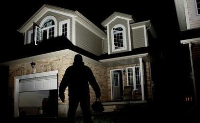 Exterior-of-house-at-night-with-man-standing-outside