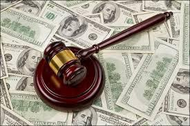 gavel-on-top-of-cash