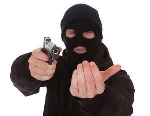 masked-robber-pointing-gun