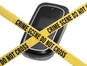 A cell phone blocked by do not cross tape