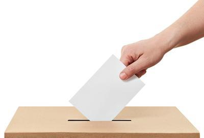Hand-dropping-ballot-in-ballot-box
