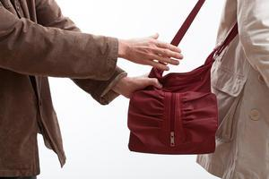 man-snatching-woman's-purse
