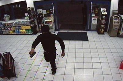 Masked-man-with-gun-entering-store
