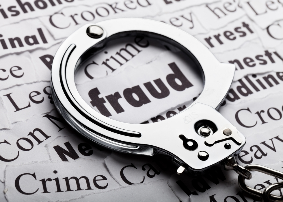 Handcuffs-around-word-fraud