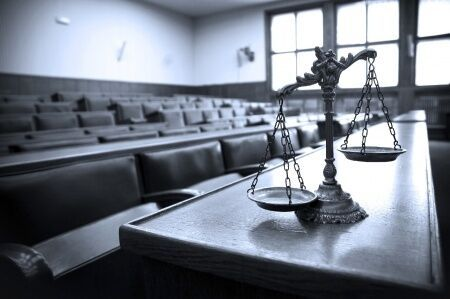 Courtroom-with-scales-of-justice