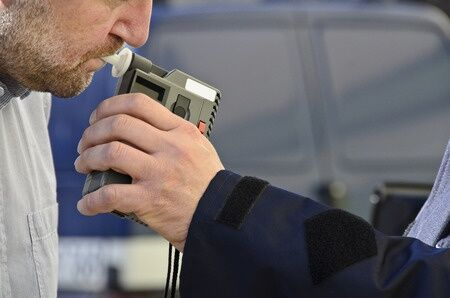 Man-taking-DUI-breathalyzer-test