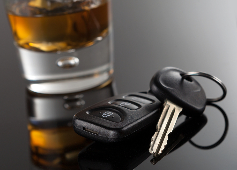 Glass-of-liquor-beside-car-keys