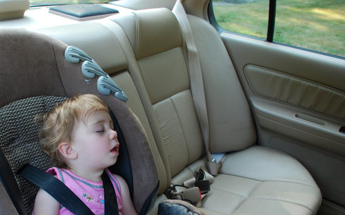 Child-in-back-seat-of-car