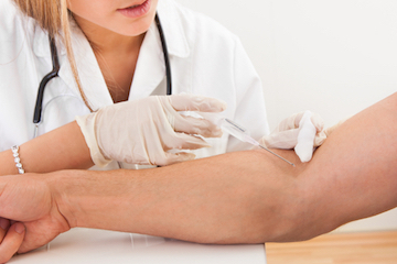 Medical-professional-drawing-blood-from-persons-arm