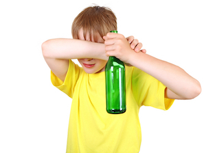 boy with bottle of alcohol