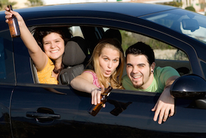 Teenagers drinking and partying in a car