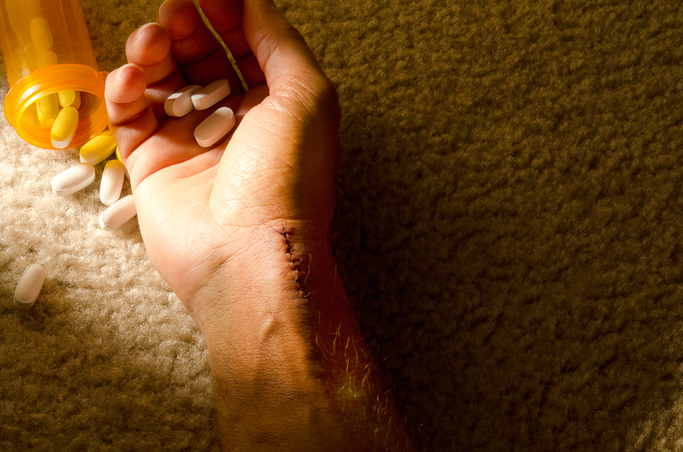 Suicide handwithpills