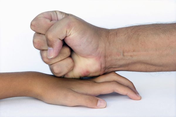 adult hand on child hand (oral copulation with a minor)