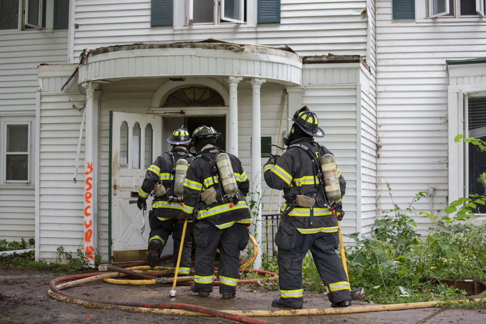 firefighters-entering-damaged-house