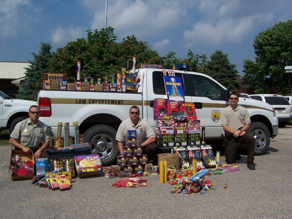 officers-standing-outside-truck-with-illegal-fireworks