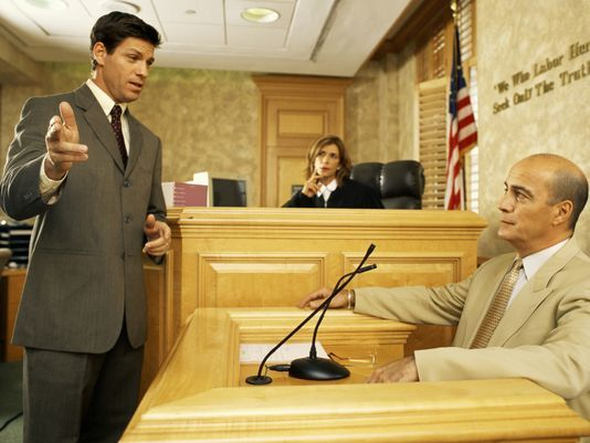 lawyer examining a witness in a courtroom